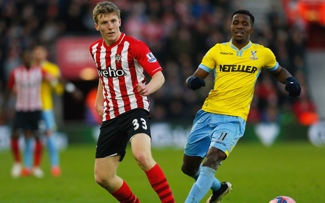 SOUTHAMPTON, ENGLAND - JANUARY 24:  Matt Targett of Southampton is watched by Wilfried Zaha of Crystal Palace during the FA Cup Fourth Round match between Southampton and Crystal Palace at St Mary's Stadium on January 24, 2015 in Southampton, England.  (Photo by Harry Engels/Getty Images)