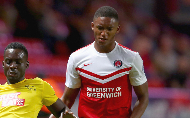 LONDON, ENGLAND - AUGUST 19:  Simon Dawkins of Derby County is challenged by Joe Gomez of Charlton during the Sky Bet Championship match between Charlton Athletic and Derby County at The Valley on August 19, 2014 in London, England.  (Photo by Clive Rose/Getty Images)