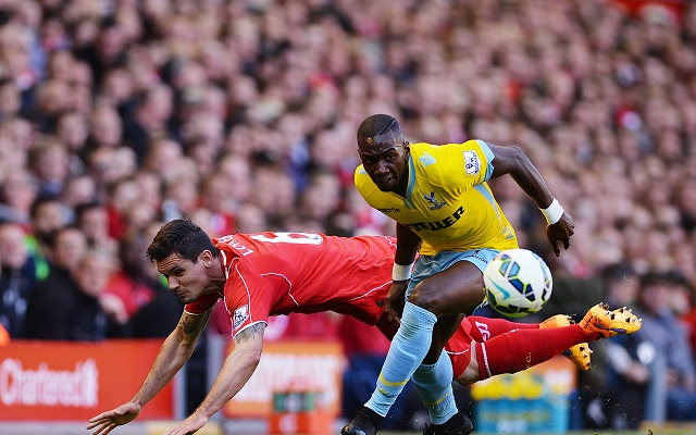 epa04751841 Liverpool's Dejan Lovren (L) in action with Crystal Palace's Yannick Bolasie (R)  during the English Premier League soccer match between Liverpool and Crystal Palace at the Anfield in Liverpool, Britain, 16 April 2015.  EPA/PETER POWELL DataCo terms and conditions apply  http://www.epa.eu/files/Terms%20and%20Conditions/DataCo_Terms_and_Conditions.pdf