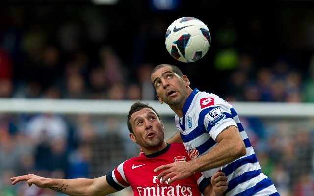 epa03687565 Queens Park Rangers' Tal Ben-Haim (R)  keeps a close watch on the ball with Arsenal's Santi Cazorla during the English Premier League soccer match between Queens Park Rangers and Arsenal London at the Loftus Road stadium, in London, Britain, 04 May 2013.  EPA/TOM HEVEZI DataCo terms and conditions apply. https://www.epa.eu/downloads/DataCo-TCs.pdf