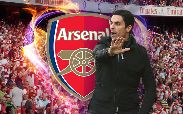 Mikel Arteta in Front of the Arsenal Logo